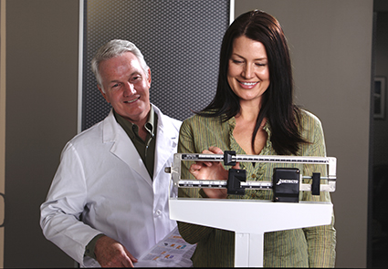 Woman on Scale with Doctor