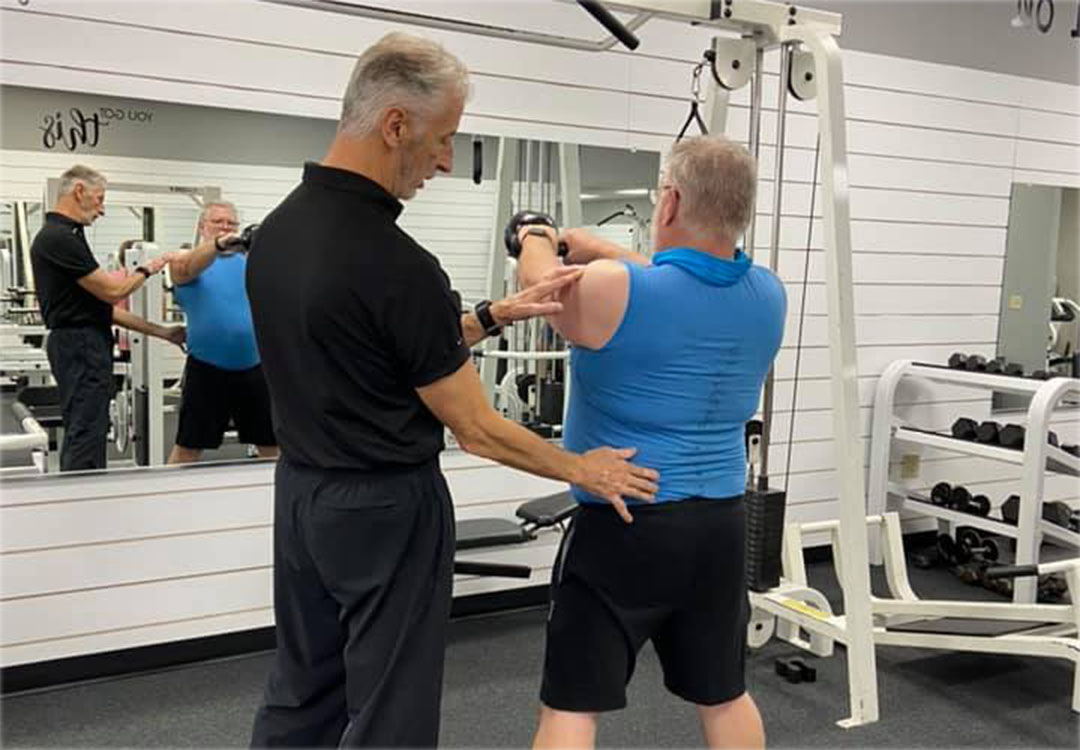 Certified Personal Trainer Dennis Training Client